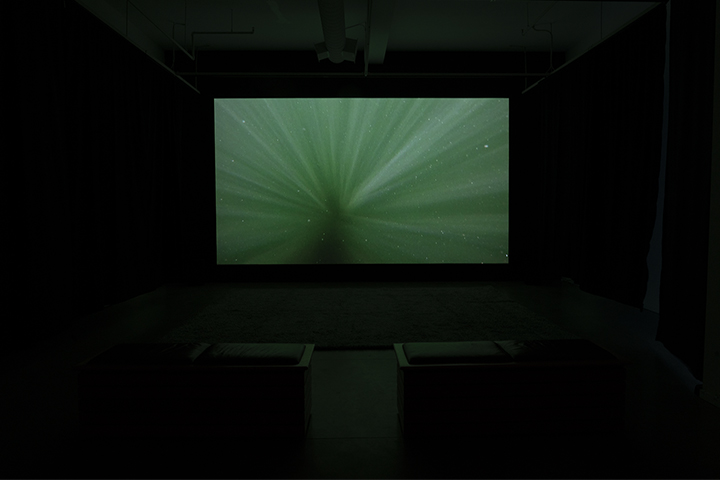 Tom Thomson Centennial Swim, installation view of 4k single channel video installation at Touchstones Museum, Nelson, 2020